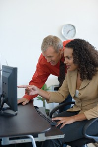 45378272_white_man_with_ethnic_woman_pointing_at_computer.thb