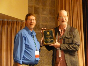 NTA President Lynn Giese presents college Program of the Year award to John Wood of  Padadena City College, CA.