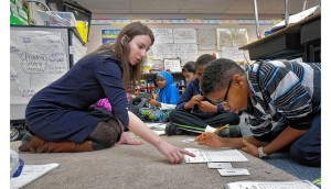 Horizon fourth-grade teacher Stephanie Force helps Justin Flemming with his math during the school's Power Hour on Jan. 5. The before-school individualized reading and math instruction runs Mondays through Thursdays. Photo by Tom Dodge/The Columbus Dispatch