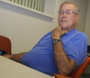 Tutor Time: Jerry Mitchell, 86, tutors students struggling to learn English at the Kendall Campus. He has served as a tutor at the campus for seven years. Photo by Eli Abasi